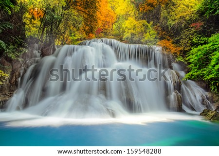 Landscspe of Waterfall with morening sunsise and jungle. - stock photo