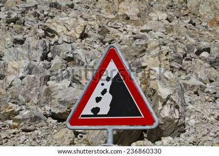 Landslide with standing in front warning board - stock photo
