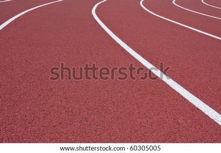 Lane lines leading off into the distance on cross country track - stock photo