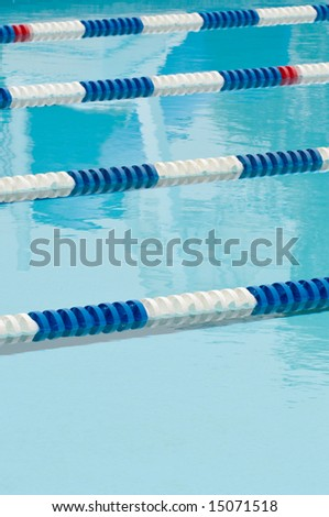 Lane separators, blue and white floats, in outdoor swimming pool - stock photo