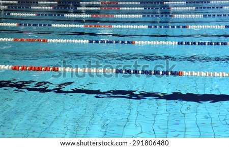 lanes for swimming pool with blue water - stock photo
