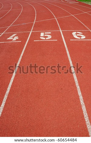 Lanes of a red race track with numbers. - stock photo