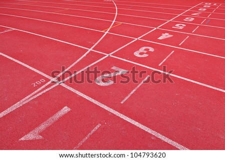 lanes of running track - stock photo