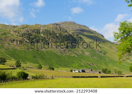 Langdale Valley Lake District Cumbria Pike of Blisco mountain near Old Dungeon Ghyll England UK in summer blue sky and clouds scenic - stock photo