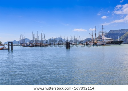 LANGKAWI, MALAYSIA - DECEMBER 19 : Ships and boat in Langkawi bay on Dec 19,13 in Langkawi. It is an administrative district with the town of Kuah as largest town which is a duty-free island.