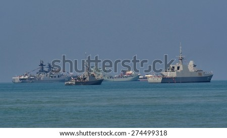 LANGKAWI, MALAYSIA - MARCH 17: Several warships were anchored near the beach, during The Langkawi International Maritime & Aerospace Exhibition (LIMA 2015) at Langkawi Malaysia on 17 March, 2015  - stock photo