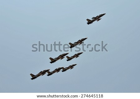 LANGKAWI, MALAYSIA - MARCH 18: UAE Aerobatic Team, Al Fursan display the show with Aermacchi MB-339 aircraft in LIMA 2015 at Langkawi Malaysia on 18 March, 2015