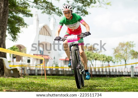 LANGKAWI, MALAYSIA - 13 OCTOBER 2014:  Eva Lechner of team Colnago Sudtirol in action during Prologue - Individual time trial at Tradewinds LIMBC 2014 on October 13, 2014.  - stock photo