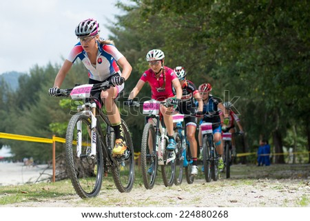 LANGKAWI, MALAYSIA - 18 OCTOBER 2014:  Janka Keseg Stevkova(front) of Outsiterz team in action at Tradewinds LIMBC 2014 on October 18, 2014.