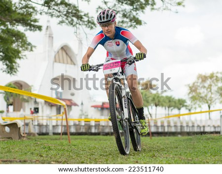 LANGKAWI, MALAYSIA - 13 OCTOBER 2014:  Janka Keseg Stevkova of team Outsiterz in action during Prologue - Individual time trial at Tradewinds LIMBC 2014 on October 13, 2014.  - stock photo