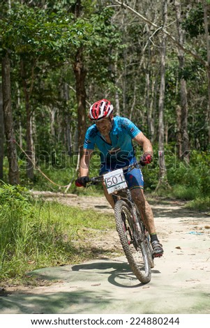 LANGKAWI, MALAYSIA - 16 OCTOBER 2014: Mads Boedker of team Specialized DaVinci in action at Tradewinds LIMBC 2014 on October 16, 2014.  - stock photo