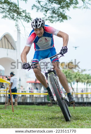 LANGKAWI, MALAYSIA - 13 OCTOBER 2014:  Michal Lami of team Slovakia National in action during Prologue - Individual time trial at Tradewinds LIMBC 2014 on October 13, 2014.  - stock photo