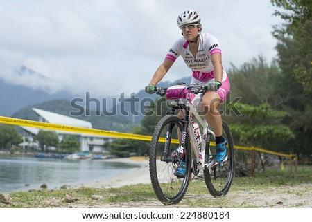 LANGKAWI, MALAYSIA - 18 OCTOBER 2014:  Nathalie Schneitter of team Colnago Sudtirol in action at Tradewinds LIMBC 2014 on October 18, 2014.  - stock photo