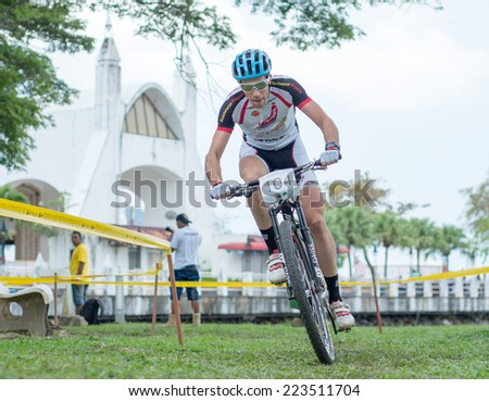 LANGKAWI, MALAYSIA - 13 OCTOBER 2014:  Nicola Rohrbach of  Goldwurst Power Stockli Team in action during Prologue - Individual time trial at Tradewinds LIMBC 2014 on October 13, 2014.  - stock photo