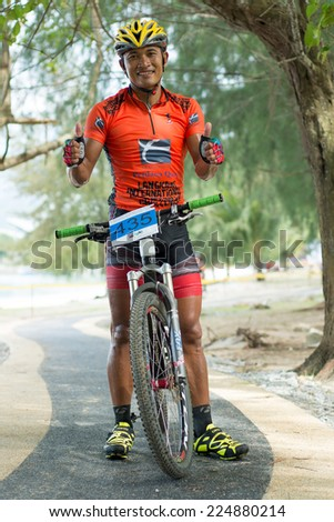 LANGKAWI, MALAYSIA - 18 OCTOBER 2014: Winner of Men Open category Seree Ruangsiri of team Endurace Thailand Tradewinds LIMBC 2014 on October 18, 2014.  - stock photo