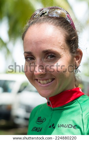 LANGKAWI, MALAYSIA - 18 OCTOBER 2014: Winner of women elite category Eva Lechner  of Colnago Sudtirol Team in at Tradewinds LIMBC 2014 on October 18, 2014.  - stock photo