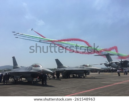 LANGKAWI - MARCH 17: Aerobatics team does a colourful flyby at the Langkawi International Maritime and Aerospace (LIMA) exhibition in Langkawi March 17, 2015