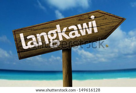 Langkawi wooden sign with a beach on background - stock photo