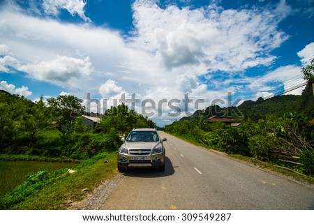LANGSON, VIETNAM, AUGUST 2, 2014: A car on the road to Bac Son town . Bac Son is a town of Lang Son province, North Vietnam.
