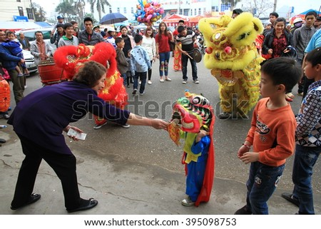 Langson, Vietnam March 05, 2016: Vietnam dancer and dragon  the traditional festival celebrations in the Ky Cung Temple Festival, Ta Phu - Social Union in Langson, Vietnam.