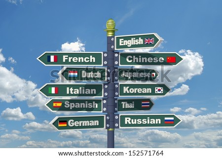 Languages signpost including English, French, Chinese, Dutch, Japanese, Italian, Korean, Spanish, Thai, German and Russian. - stock photo