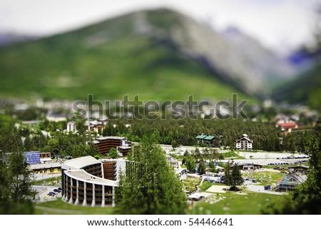 lanscape of mountain village with tilt shift lens effect - stock photo