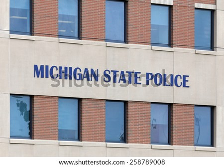 LANSING, MI - AUGUST 1: The Michigan State Police Headquarters building in Lansing, Michigan on August 1, 2014. The Michigan State Police is the state police agency for the state of Michigan. - stock photo