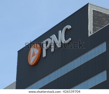 LANSING, MI - MARCH 27:  PNC Bank, whose Lansing location is shown on March 27, 2016, has more than 2,700 branches. - stock photo