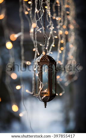 Lantern and led christmas lights hanging