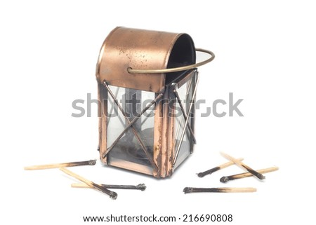 Lantern and match on isolate - stock photo