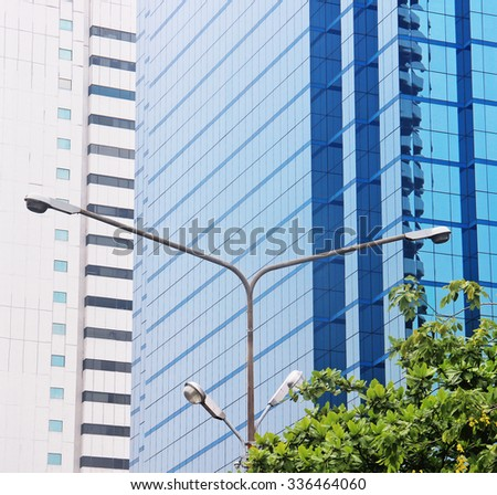 Lantern and skyscrapers in the city - stock photo