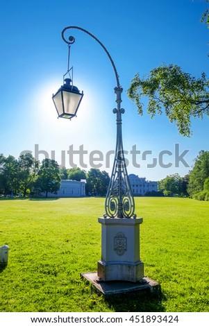 Lantern and yelagin palace on background in sunny morning - stock photo