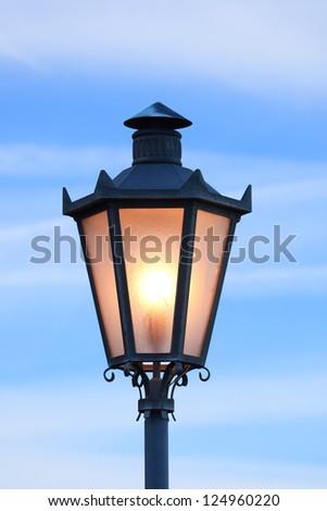 Lantern glowing in morning twilight, San Marino (Italy) - stock photo