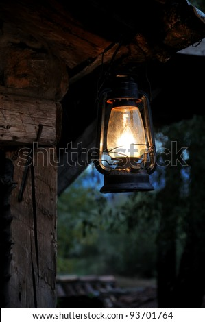 Lantern hang in front of wooden house in the night