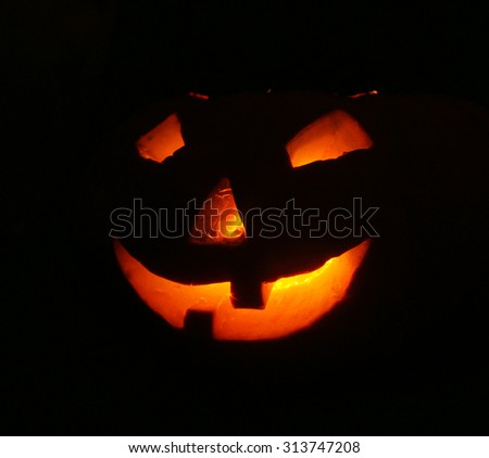 lantern, illuminating pumpkin in dark night - stock photo