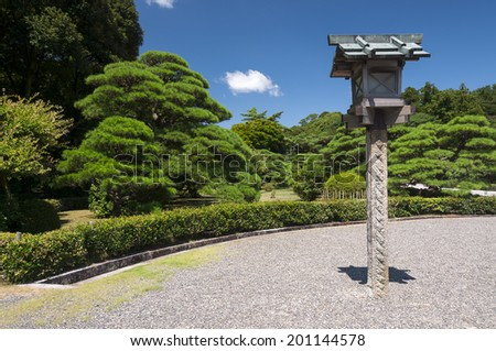 Lantern in the garden of complex Ise Jingu, Japan - stock photo