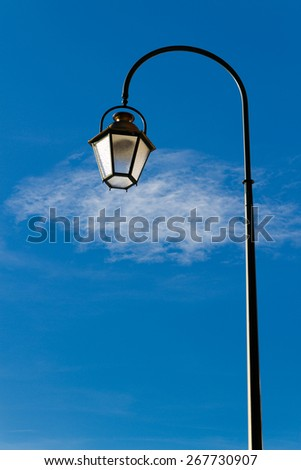 lantern on a background of blue sky with clouds