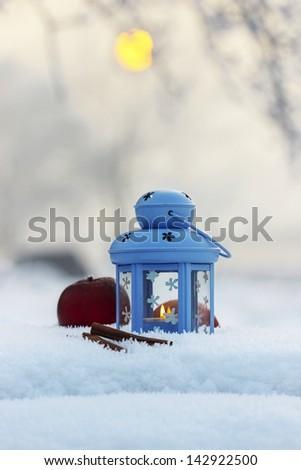 Lantern on snow, selective focus - stock photo