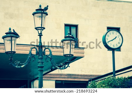 Lantern on the facade of old italian house. Venice - stock photo