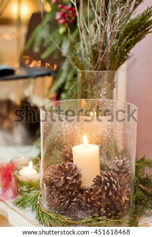 lantern with candle with spruce branch - stock photo