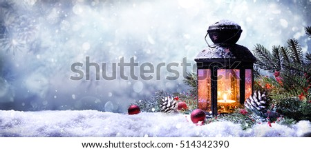 Lantern With Fir Branches On Snow