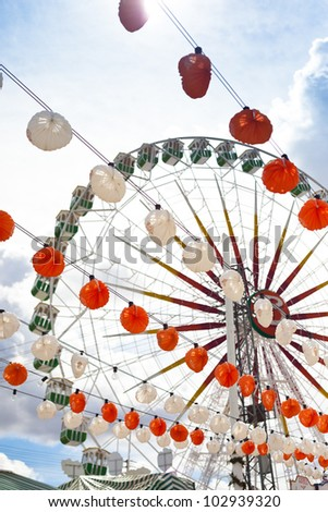 Lanterns and ferris wheel. - stock photo
