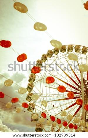 Lanterns and ferris wheel. Vintage. - stock photo