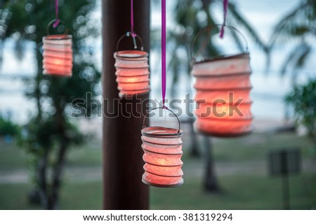 Lanterns of paper in the gazebo at sunset - stock photo