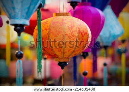 Lanterns sale for Mid-Autumn festival ( Trung Thu ) in Cho Lon market, Ho Chi Minh City, Vietnam. Parents in a few Asian countries like to buy lanterns for their children at Mid Autumn festival. - stock photo