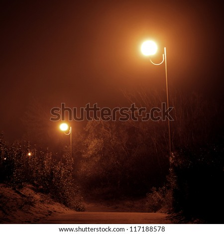 Lanterns shining in the fog - stock photo