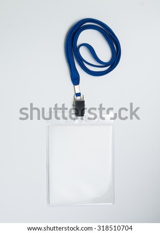 Lanyard and badge. Conference badge. Blank badge template in plastic holder with blue strap.
