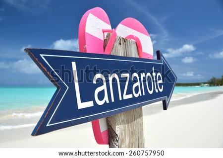 Lanzarote arrow on the beach - stock photo