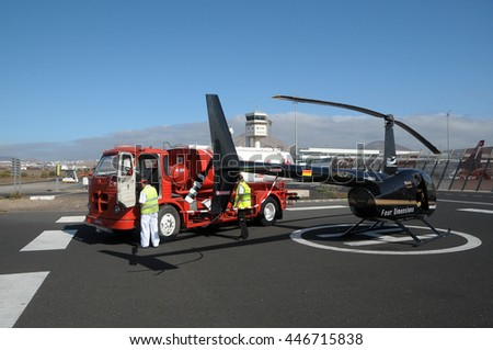 LANZAROTE, CANARY ISLANDS - SEPTEMBER 15, 2008: Robinson R44 helicopter , refueling in Lanzarote airport
