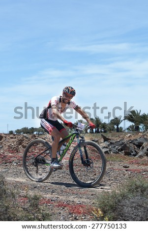 "LANZAROTE, SPAIN - MAY 03: Abraham Roman N191 in action at Adventure mountain bike marathon ""Ultrabike Santa Rosa"" May 03, 2015. Lanzarote, Canaries islands, Spain."